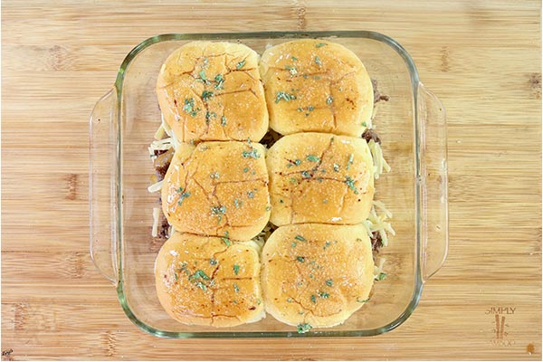 Overhead process shot: sliders in a baking dish, ready to go into the oven