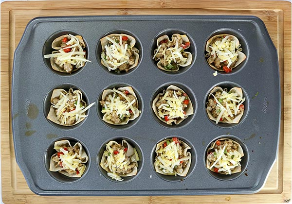 overhead process shot: wonton cups and filling in a muffin tin
