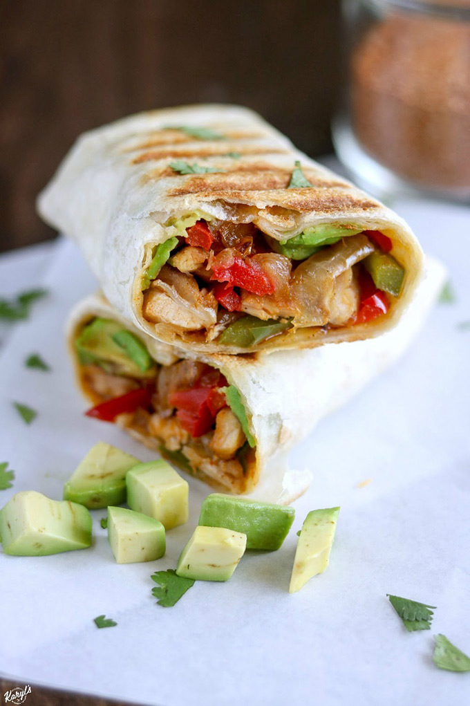 Crispy Chicken Fajita Wrap cut in half and stacked, with diced avocado on the side